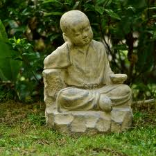 resting monk statue